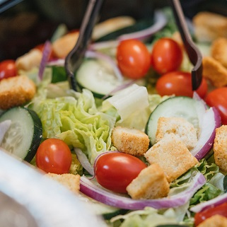 Salad with croutons, cherry tomatoes, and cucumbers with a hint of onion.