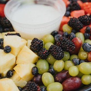 Fruit plate with grapes, pineapple, and berries.